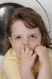 Little girl picking her nose Stock Photography