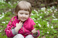 Little girl picking snowdrops Royalty Free Stock Images