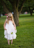 Little girl. Picking some green apples Royalty Free Stock Photography