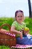 Little girl with picnic basket and apple Royalty Free Stock Photos