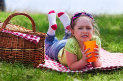 Little girl with picnic basket and plastic cup Royalty Free Stock Images