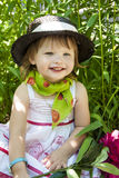 Little girl on a picnic. Little girl  on a picnic on the green background with  flower Stock Images