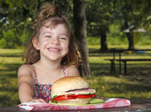 Little girl picnic in park Royalty Free Stock Photography