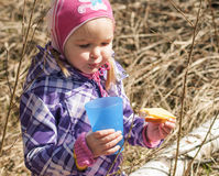 Little girl on a picnic. In the woods Royalty Free Stock Photography