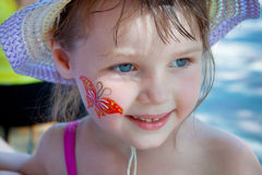 Little girl with a picture on the cheek Royalty Free Stock Photos