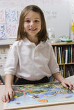 Little Girl With A Picture Puzzle Royalty Free Stock Photos