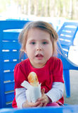 Little girl with pie Royalty Free Stock Image