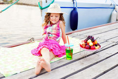 A little girl at the pier near the lake Royalty Free Stock Photos