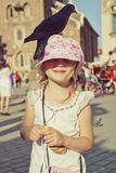 Little girl with pigeon on the head Royalty Free Stock Images