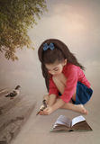 Little girl with pigeons Royalty Free Stock Photo