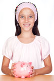 Little girl with with piggy-bank. Isolated on white background Royalty Free Stock Photography