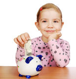 Little girl with piggy bank Stock Photography