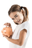 Little girl with a piggy-bank Royalty Free Stock Photography