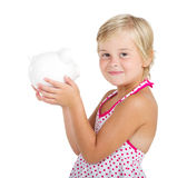 Little girl piggy bank Stock Image