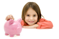 Little girl with piggy bank royalty free stock image
