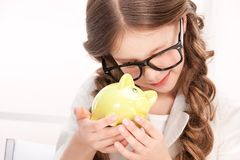 Little girl with piggy bank Stock Images