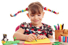 Little girl with pigtails drawing Royalty Free Stock Photo