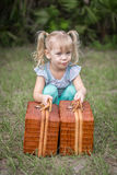 Little girl in pigtails lifting baskets Stock Photography