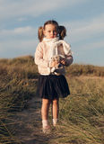 Little girl with pigtails outdoors Royalty Free Stock Photos