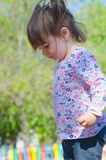 Little girl with pigtails in the park Royalty Free Stock Photos