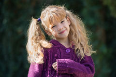 Little girl with pigtails Stock Images