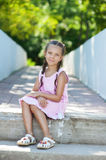 Little girl with pigtails sitting Royalty Free Stock Photo