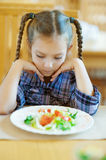 Little girl with pigtails sitting Stock Photos
