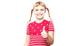 Little girl with pigtails smiles and thumb up Royalty Free Stock Images