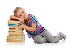 Little girl with a pile of books Stock Image