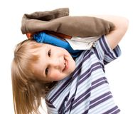 Little girl with a pile of T-shirts Royalty Free Stock Images