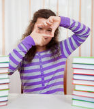 Little girl with piles of books Royalty Free Stock Image