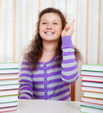 Little girl with piles of books Royalty Free Stock Images