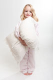 Little girl with pillow Stock Photos
