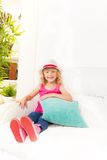 Little girl with pillow and hat Stock Photos