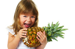 Little girl with pineapple Stock Photo