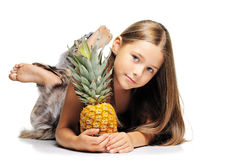 Little girl with pineapple. Portrait of blond small girl on white background Royalty Free Stock Photo