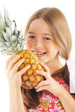 Little girl with pineapple. In hands. On white background Royalty Free Stock Photography