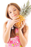 Little girl with pineapple. Posing over white background Royalty Free Stock Photos