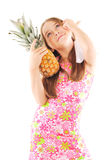 Little girl with pineapple. Posing over white background Royalty Free Stock Photography