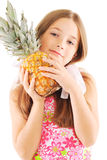 Little girl with a pineapple Stock Photos