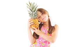 Little girl with a pineapple. Little girl with pineapple on white background Stock Images