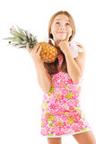 Little girl with a pineapple. White background Stock Photography
