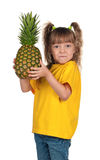 Little girl with pineapple Stock Image