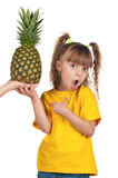 Little girl with pineapple Royalty Free Stock Images