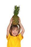 Little girl with pineapple Royalty Free Stock Image