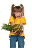 Little girl with pineapple Royalty Free Stock Photography