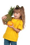 Little girl with pineapple Stock Photography
