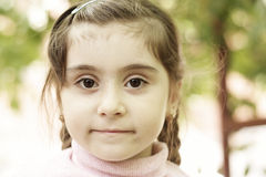 Little girl in pink Stock Image