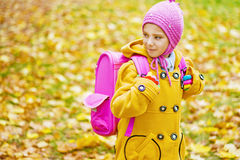 Little girl with pink backpack goes Stock Images