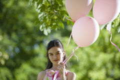 Little girl with pink balllons Royalty Free Stock Photo